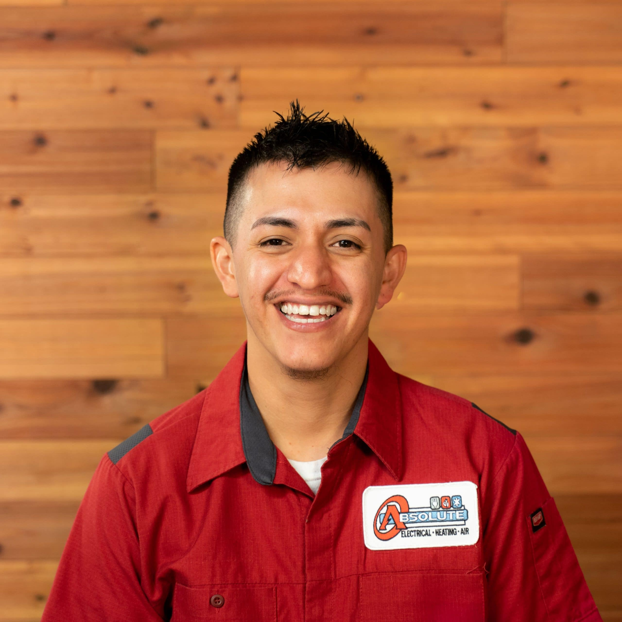 Adam HVAC Technician in Red for Absolute Electrical Heating and Air